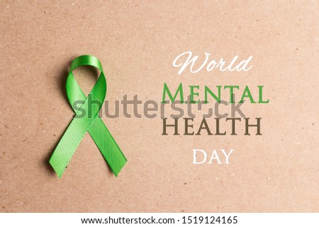 World mental health day concept. Green awareness ribbon a paper brown bbackground.  #1519124165