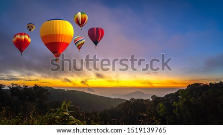 Colorful hot air balloons flying over mountain at Dot Inthanon in Chiang Mai, Thailand.  #1519139765