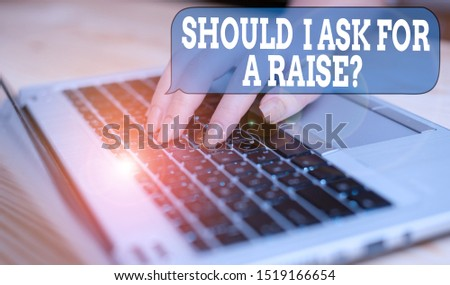 Writing note showing Should I Ask For A Raise Question. Business photo showcasing deanalysisding increase in your month salary woman with laptop smartphone and office supplies technology. #1519166654