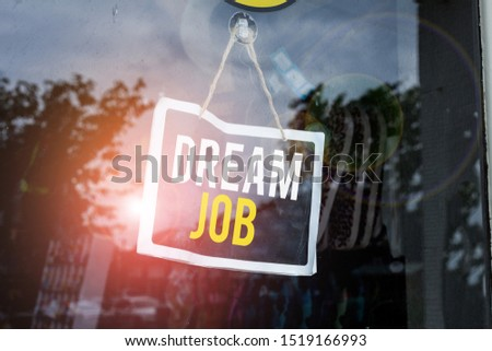 Text sign showing Dream Job. Conceptual photo An act that is paid of by salary and giving you hapiness Empty black board with copy space for advertising. Blank dark board. #1519166993
