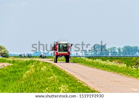 Agricultural machine driving on a country road in Groningen, the Netherlands, Europe. #1519193930