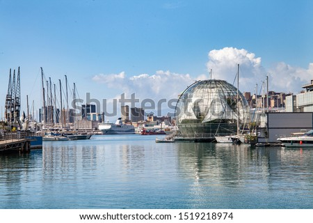 view of the bay of Genoa with the Renzo Piano Biosphere, some boats moored and a large ferry in the background, calm sea. #1519218974