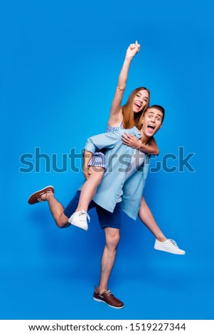Vertical full length body size view of two nice attractive excited cheerful cheery glad positive people piggy-backing having fun isolated on bright vivid shine vibrant blue color background #1519227344