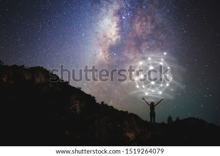 noise pic,Thought-free, young woman standing at the wooden bridge destination With the Milky Way leaning over the sky at night