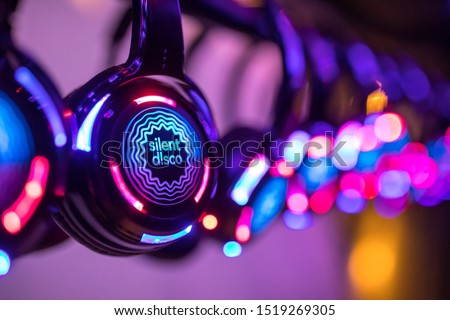 Silent Disco colorful headphones at event Royalty-Free Stock Photo #1519269305