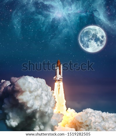 Cloudy launch of rocket Space Shuttle into colorful starry outer space and the full moon. The elements of this image furnished by NASA . #1519282505