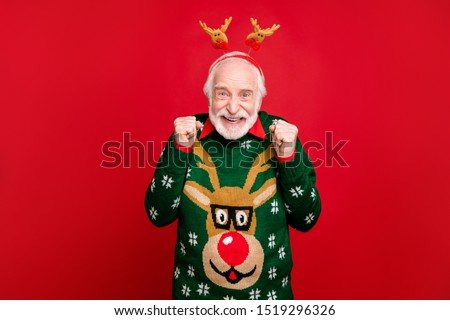 Photo of funny santa man with pretty horns on head celebrating newyear surprise visit from children wear x-mas ugly ornament sweater isolated red background #1519296326