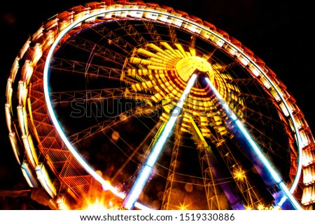 Time Exposure Nightphotography of funfair rides on a German Christmas market
