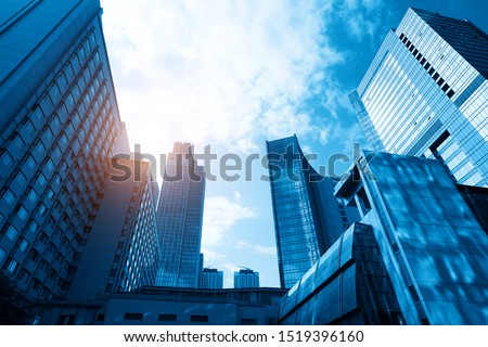 Looking Up Blue Modern Office Building #1519396160