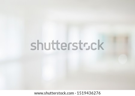 Empty corridor hallway of modern white office building room with glass entrance door business blur background, corridor in a bright room, empty space