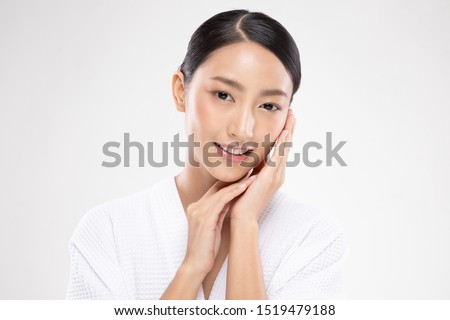 Beautiful Asian young woman touching soft cheek smile with clean and fresh skin Happiness and cheerful with positive emotional,isolated on white background,Beauty and Cosmetics Concept #1519479188