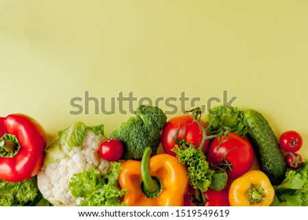Healthy clean eating layout, vegetarian food and diet nutrition concept. Various fresh vegetables ingredients for salad on yellow table background, top view, frame, banner #1519549619
