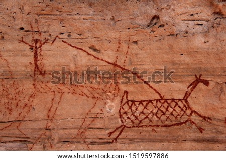 "Rock painting in the region of ""Serra da Capivara"" - State of Piaui - Northeast Brazil. The picture seems to depict hunters hunting deers."