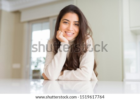 Beautiful brunette woman smiling cheerful with big smile, looking positive and happy with crossed arms #1519617764