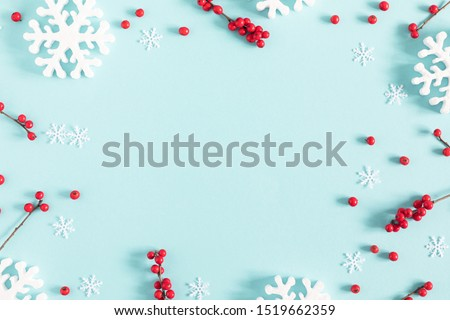 Christmas holiday composition. Xmas white decorations and red berries on pastel blue background. Christmas, New Year, winter concept. Flat lay, top view, copy space #1519662359