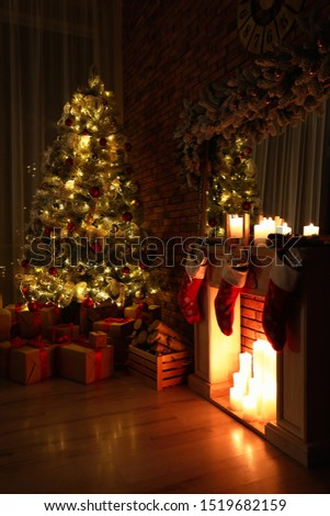 Stylish room interior with beautiful Christmas tree in evening #1519682159