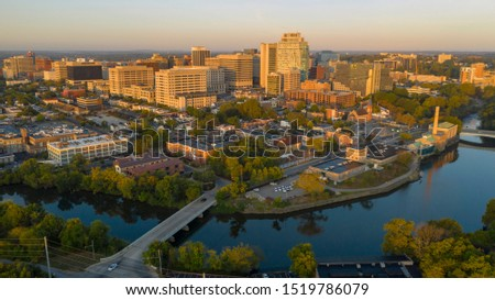 Saturated early morning light hits the buildings and architecture of downtown Wilmington Delaware Royalty-Free Stock Photo #1519786079