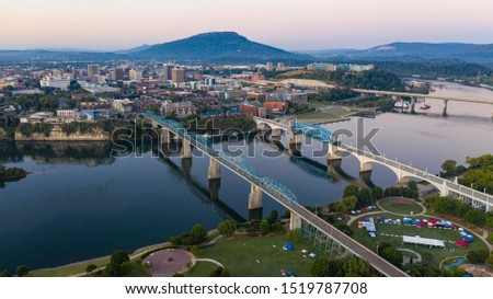 Aerial view of a bend in the Tennessee River flowing around beautiful Chatanooga TN #1519787708