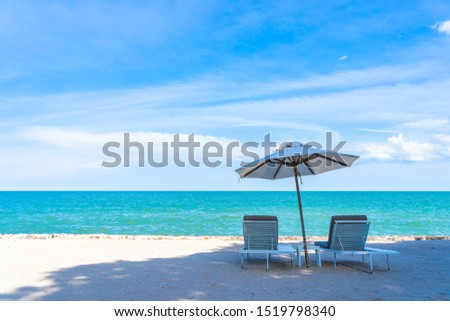 Beautiful umbrella and chair around beach sea ocean with blue sky for travel vacation #1519798340