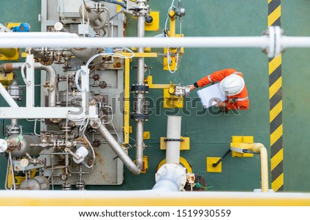 Mechanical operator checking centrifugal pump condition for daily checking oil pump system to maintain reliability of oil and gas production process. #1519930559