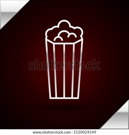 Silver line Popcorn in cardboard box icon isolated on dark red background. Popcorn bucket box.  Vector Illustration #1520024549