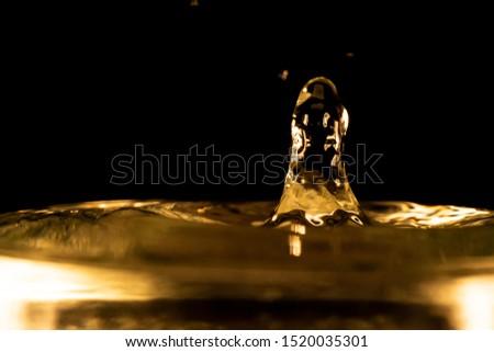 Water splash, golden water splash isolated on black background,water #1520035301
