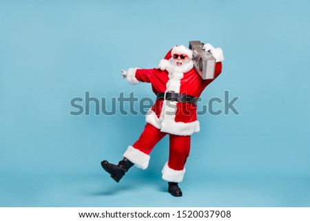 Full length body size view of his he nice cool fat cheerful cheery glad excited carefree bearded Santa clubber carrying tape player dancing clubbing isolated on blue turquoise pastel color background #1520037908
