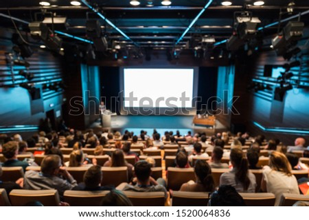 DEFOCUSED image of speaker giving a talk in conference hall at business event. Audience at the conference hall. Business and Entrepreneurship concept. #1520064836