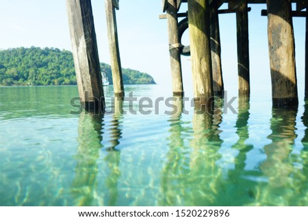 The wood pier stretched out into the sea.The sky and water clear.Suitable for relax time. #1520229896