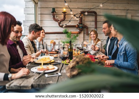 Group of young people having lunch on a terrace of an apartment at sunset - Millennials have fun together on a day of celebration #1520302022