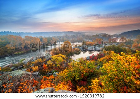 beautiful autumn landscape with colorful trees and foggy river on sunset  #1520319782