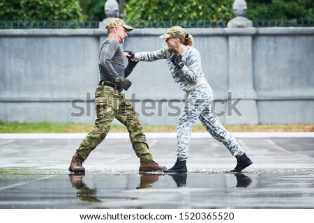 hand to hand combat between military instructor with female trainee Royalty-Free Stock Photo #1520365520