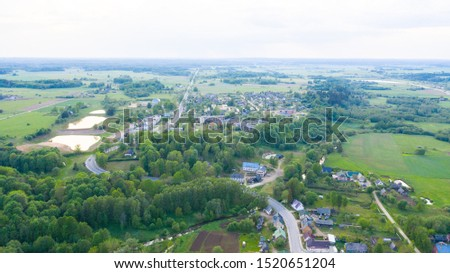 Aerial view from drone on Akniste in Latvia. Beautiful landscapes on small town fields and forests. #1520651204