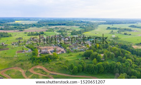 Aerial view from drone on Akniste in Latvia. Beautiful landscapes on small town fields and forests. #1520651207