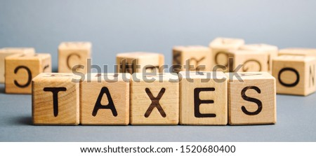 Wooden blocks with the word Taxes. Business and finance concept. Tax and taxation. The tax burden #1520680400