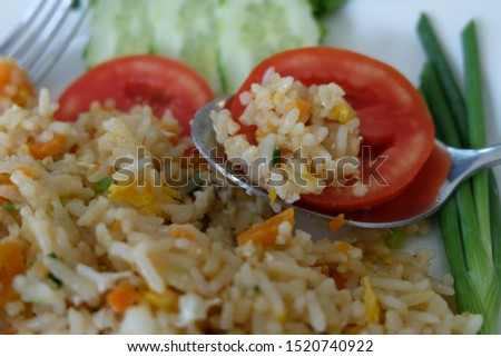 Fried rice with eggs, tomatoes and cucumber. Fried rice is one of Asian food. #1520740922