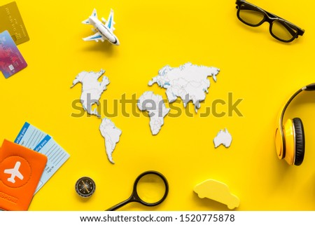 Planning a travel concept. Sketchy map of the world on yellow background top view #1520775878