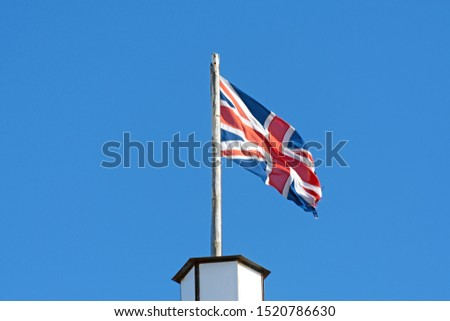 The union jack flag the national flag of great Britain blowing in the wind #1520786630