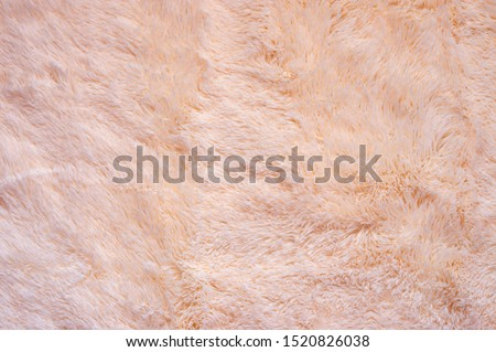 Pink shaggy blanket texture as background. Fluffy fake textile fur. Royalty-Free Stock Photo #1520826038