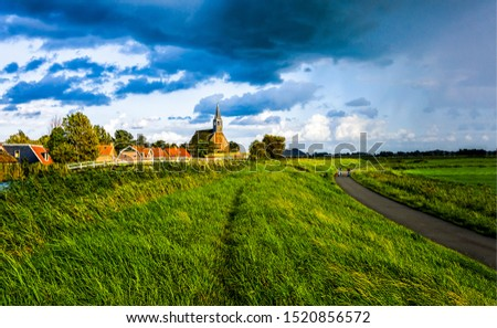 Rural road in windy day. Windy village pathway. Windy weather village scene. Windy village landscape #1520856572