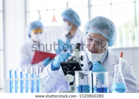 Asian scientist team has researching in laboratory. #1520860280