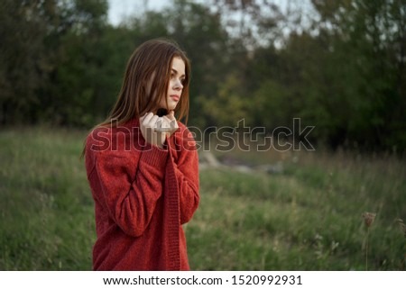 stylish beautiful woman outdoors young in red #1520992931