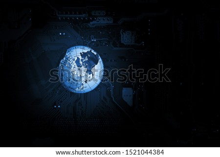 world globe on computer circuit board in the dark. #1521044384