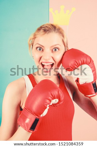 Workout done, have your fun. Cute boxer girl with party prop. Funny woman with crown prop in boxing gloves. Athletic woman in sports wear. Sportswoman with princess look. Boxing is fun for her. #1521084359