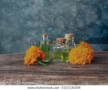 Cold pressed calendula oil made from marigold flower,  Natural extracts on vintage background #1521136304