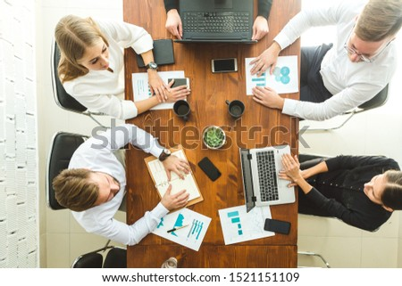 A team of young businessmen working and communicating together in an office. Corporate businessteam and manager in a meeting. #1521151109