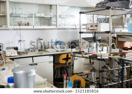 Biochemical laboratory interior with different lab equipment and glassware #1521185816