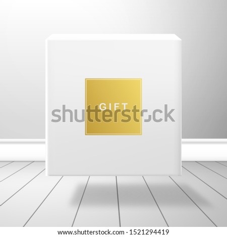 A white box falls on the plank floor. Gold label with the inscription Gift #1521294419