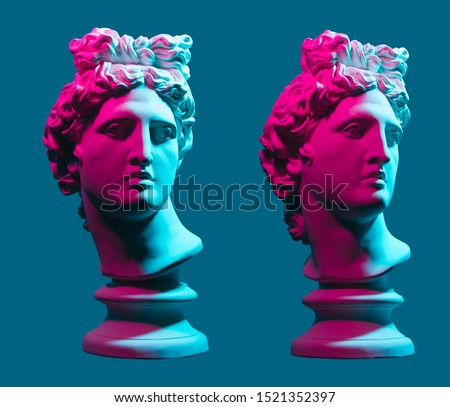 Statue neon. On a blue isolated background. Gypsum statue of Apollo's head. Man. #1521352397