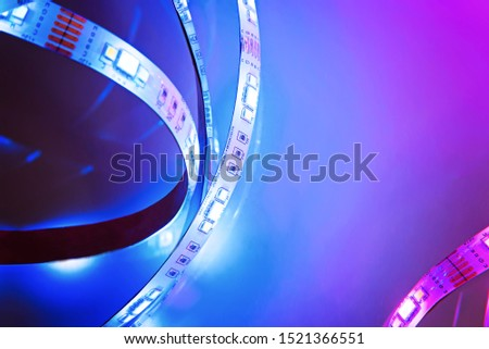 Bright neon LED strip glows blue and pink. Copyspace. #1521366551